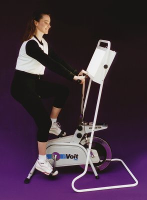 [Picture of woman riding exercise bike with Bio-Light bright light therapy system for seasonal affective disorder]