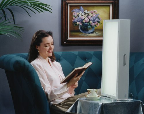 [Picture of woman reading book with Bio-Light bright light therapy system for seasonal affective disorder]